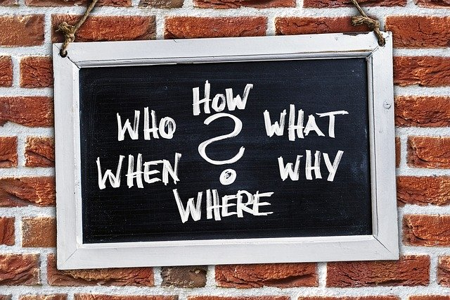 Animated board on a wall with How, who, what, when, why and where written on it
